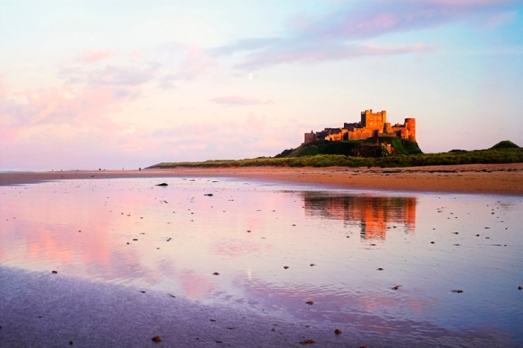 Bamburgh Castle across the sands of Bamburgh Beach, Northumberland.