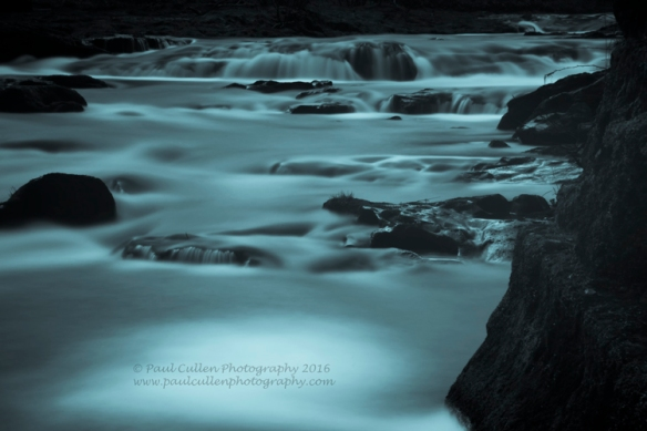 Abstract river flow - water taking on a milky form through long exposure.